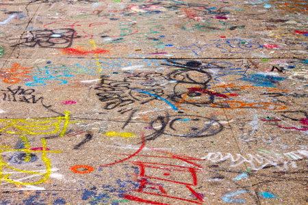 vandalize: Graffit covered sidewalk in New York City
