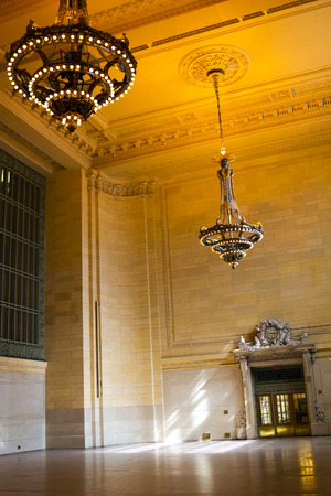 historic site: Sunlight shining through windows in the entrance to Grand Central Station in New York City