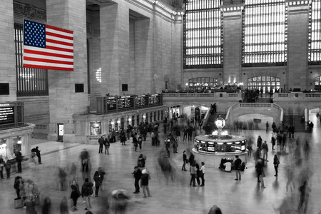 black train: Red White and Blue American flag Hanging in Black and White Grand Central Station, New York City