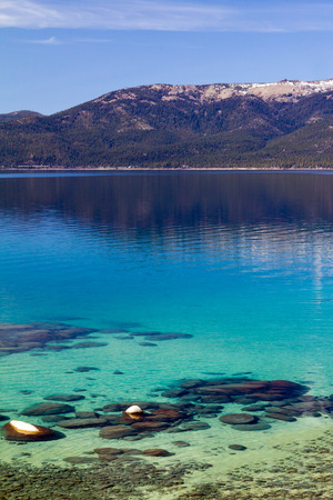 blue waters: Crystal clear blue waters of Lake Tahoe in California Stock Photo