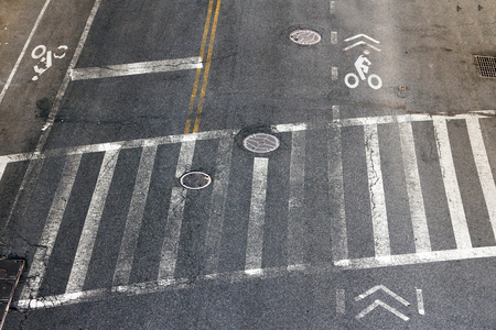 rough road: City street crosswalk and bike lanes in New York City Stock Photo