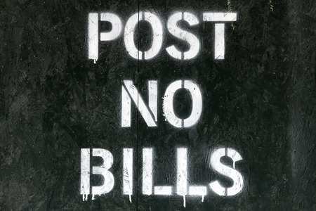 sign post: Post no bills spray painted sign in New York City