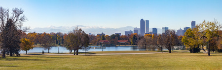 denver skyline with mountains: Denver, Colorado Skyline and Front Range Moutains Panoramic Landscape seen from City Park