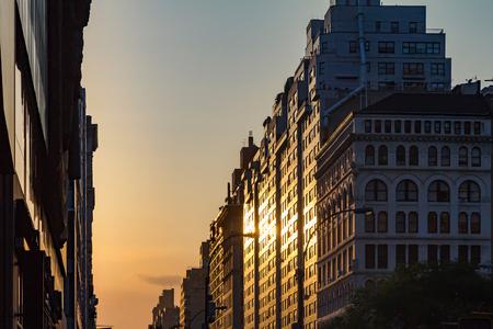 sunset city: Manhattanhenge solstice sunset in New York City Stock Photo