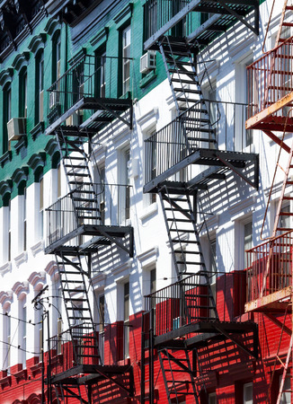 Block of painted apartment buildings in Little Italy in Manhattan, New York City