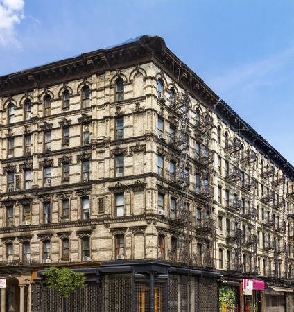 nyc apartment buildings. Historic New York City apartment building in Manhattan photo Block Of Colorful Apartment Buildings With Fire