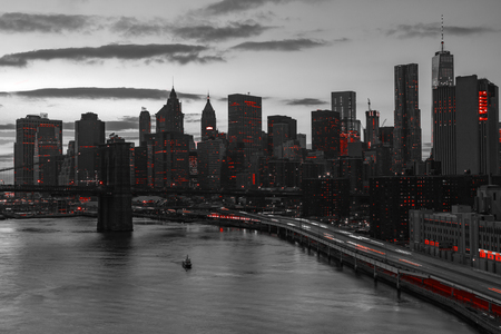 New York City night skyline with red lights in black and white landscape Stockfoto