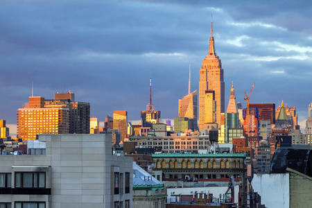 boroughs: Sunlight glows on the buildings of New York City at sunset in Manhattan