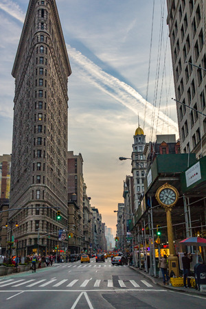 NEW YORK CITY – CIRCA 2016: The Flatiron Building stands between Broadway and Fifth Avenue on a busy Saturday evening in Manhattan, New York City. The Flatiron Building is a 22 story triangular shaped building built in 1902.