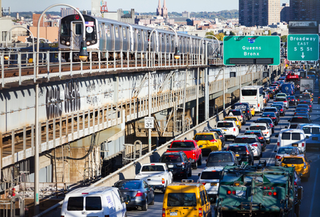 NEW YORK CITY – OCTOBER 15: Heavy traffic back ups on the Williamsburg Bridge while a subway train passes by during rush hour in New York City on October 15, 2015. The bridge connects Lower Manhattan with the borough of Brooklyn.