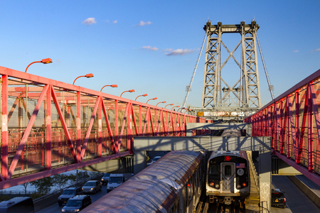 ny: NEW YORK CITY - CIRCA 2015: Subway trains cross the Williamsburg Bridge during the rush hour commute in New York City. The bridge connects the Lower East Side of Manhattan with the Williamsburg neighborhood of Brooklyn, Editorial