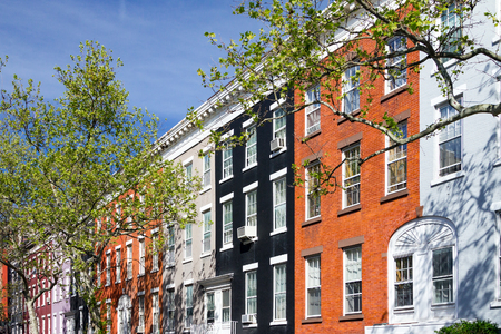 ny: Colorful apartment buildings on Macdougal Street in the Greenwich Village neighborhood of Manhattan in New York City