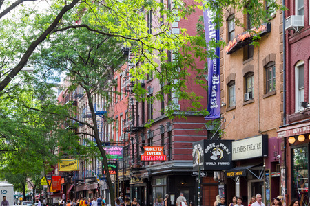 crowds of people: NEW YORK CITY – JULY 2016: Crowds of people walk by the many shops and restaurants of Macdougal Street in the Greenwich Village neighborhood of Manhattan in New York City on a busy day on Forth of July weekend in 2016.
