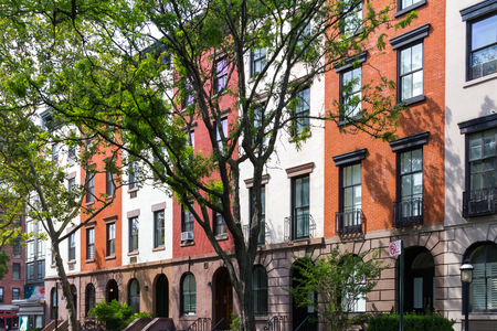 Tree Lined Block of Apartment Buildings in Manhattan, New York City Stock Photo