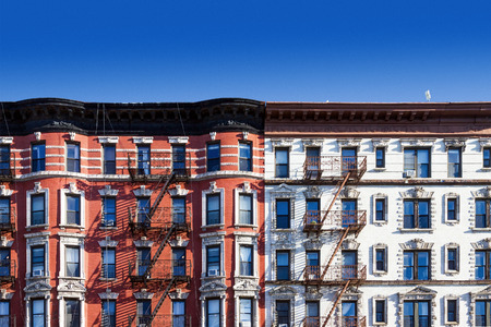 New York City block of old historic apartment buildings in the East Village of Manhattan, NYC with a clear blue sky background Editorial
