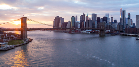 New York City panorama landscape scene at sunset with Brooklyn Bridge over the East River and Lower Manhattan skyline skyscrapers Reklamní fotografie