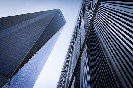 Geometric shapes of tall skyscrapers set against a clear sky background in downtown New York City NYC Stock Photo