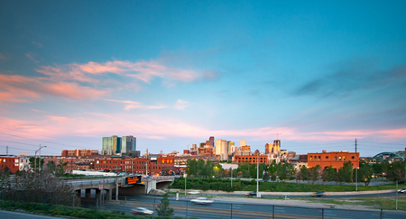 denver buildings: Denver, Colorado panoramic downtown skyline at sunset with colorful clouds in the sky above