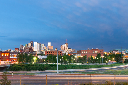 denver buildings: Sunset light reflects off the buildings of downtown Denver, Colorado Stock Photo