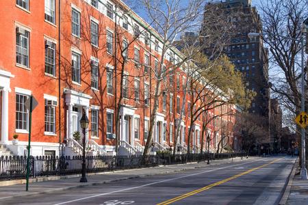 Block of historic buildings along an empty street along Washington Square Park in Manhattan, New York City NYC