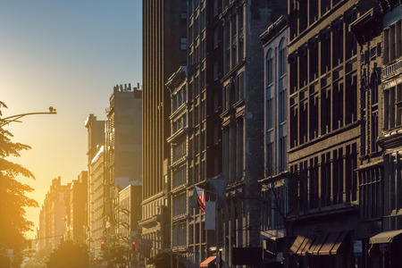 Sunset light shines on a block of buildings in New York City NYC
