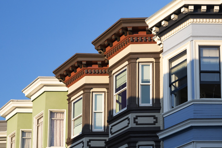 Row of colorful historic buildings with bay windows in San Francisco, California