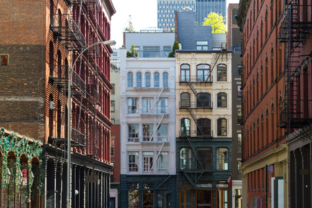 Historic buildings at the intersection of Crosby and Howard Street in the SOHO neighborhood of Manhattan, New York City NYC