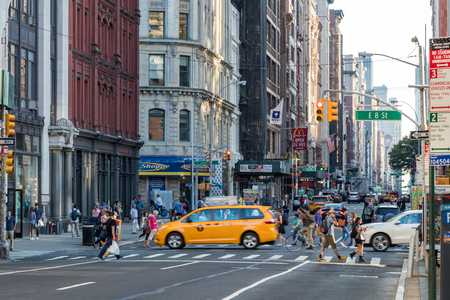 NEW YORK CITY - CIRCA 2017: People and cars cross the busy intersection of Broadway and 8th Street in Manhattan, New York City in 2017.