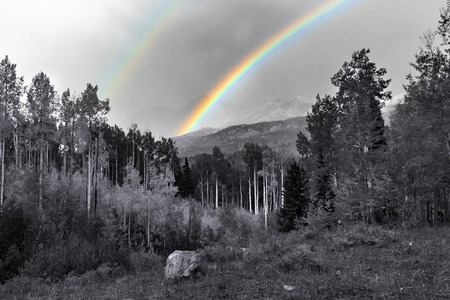 Double rainbow above black and white mountain landscape in Colorado Stock Photo