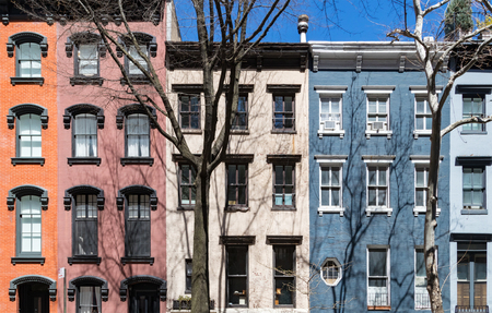 Rows of windows on colorful old buildings in the Gramercy Park neighborhood of Manhattan in New York City NYC