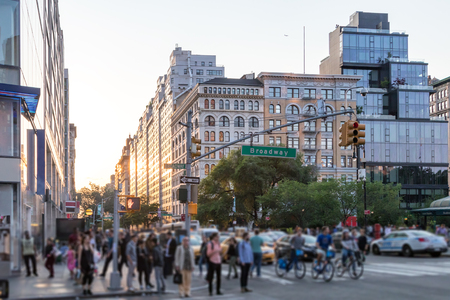 Crowds of people crossing Broadway near Union Square Park in Manhattan New York City NYC Sajtókép