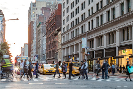 Fast paced street scene with people walking across a busy intersection on Broadway in Manhattan New York City Sajtókép