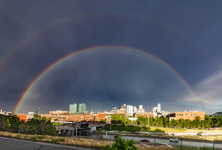 Double rainbow above the downtown skyline after a storm in Denver, Colorado