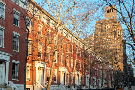 Afternoon sunlight shines on the historic buildings along Washington Square Park in Manhattan, New York City