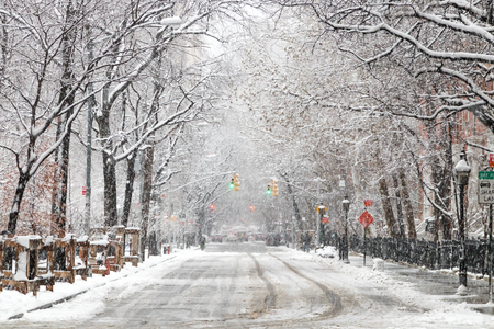 Snow covered street along Washington Square Park after a nor'easter snow storm in New York City NYC