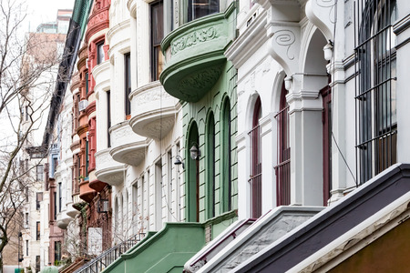Colorful row of historic homes along West 80th Street in the Upper West Side neighborhood of Manhattan, New York City