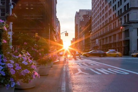 Colorful New York City street scene with flowers and sunset