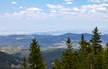 View of downtown Denver, Colorado city skyline seen from the front range mountains Stock Photo