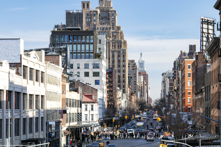 Busy view of 14th Street with crowds of people scene from the Highline Park in Chelsea New York City NYC