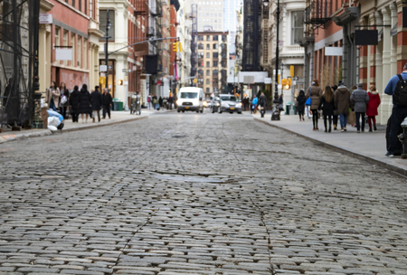 View of cobblestone covered Greene Street with bright sunlight background in the SoHo neighborhood of Manhattan, New York City 版權商用圖片