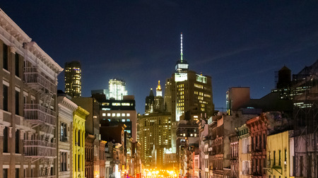 New York City skyline view at night of the buildings in lower Manhattan with colorful lights