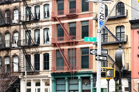 Block of colorful old apartment buildings on 6th Avenue in the Tribeca neighborhood of New York City NYC