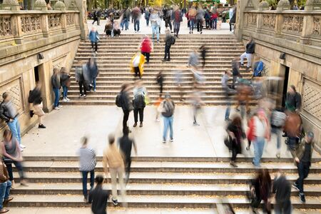 Overhead view of busy crowds of people walking up and down the steps at Bethesda Terrace in Central Park, New York City NYC 免版税图像