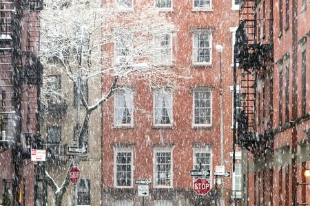 Blowing snow covers the buildings on Waverly Place in the Greenwich Village neighborhood of New York City NYC