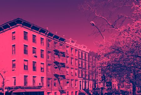 Buildings on 10th Street in the East Village of New York City with pink and blue duotone color effect