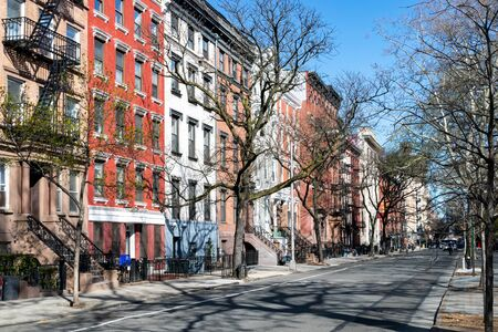 Colorful old buildings line the empty sidewalks along 10th Street in the East Village neighborhood of New York City NYC