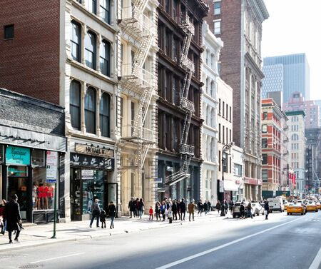 NEW YORK CITY CIRCA 2019: The street is crowded with people shopping at the stores along Broadway in the SoHo neighborhood of Manhattan in New York City.