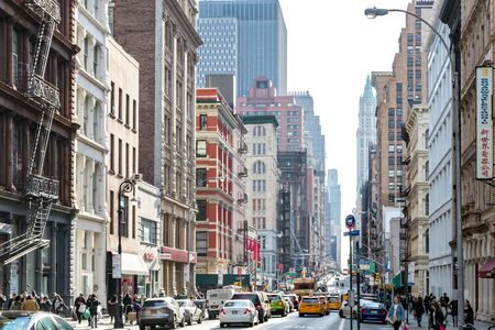 NEW YORK CITY CIRCA 2019: The streets and sidewalks are crowded with busy people in the SoHo neighborhood of Manhattan in NYC 写真素材