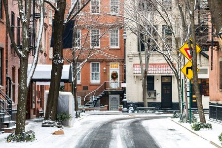 Snowy winter scene on Commerce Street in the Greenwich Village neighborhood of Manhattan in New York City NYC
