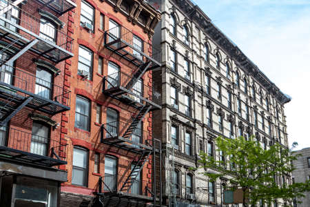 Outdoor view of a block of historic buildings on Orchard Street in the Lower East Side neighborhood of Manhattan in New York City NYC Editorial